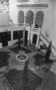Black and white photograph of courtyard in front of the Moroccan Pavilion