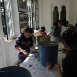 Children paint in the rooms off the courtyard