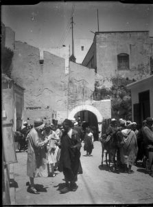 Europeans and Moroccans in front of Bab Dar Dbagh, ca. 1920